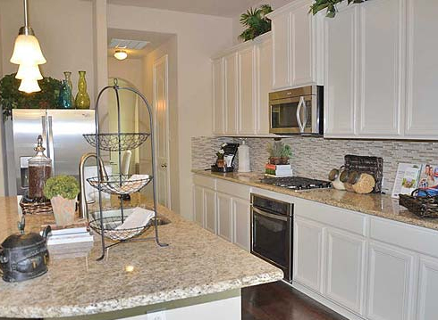 Kitchen with Stainless Appliences and Granite Counters